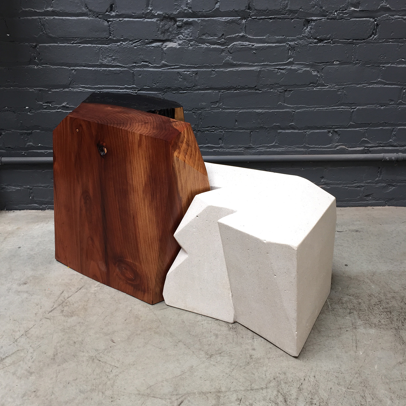 ReUpped. Fire & Ice, 2015. Redwood and concrete, 20 x 36 x 14 in.