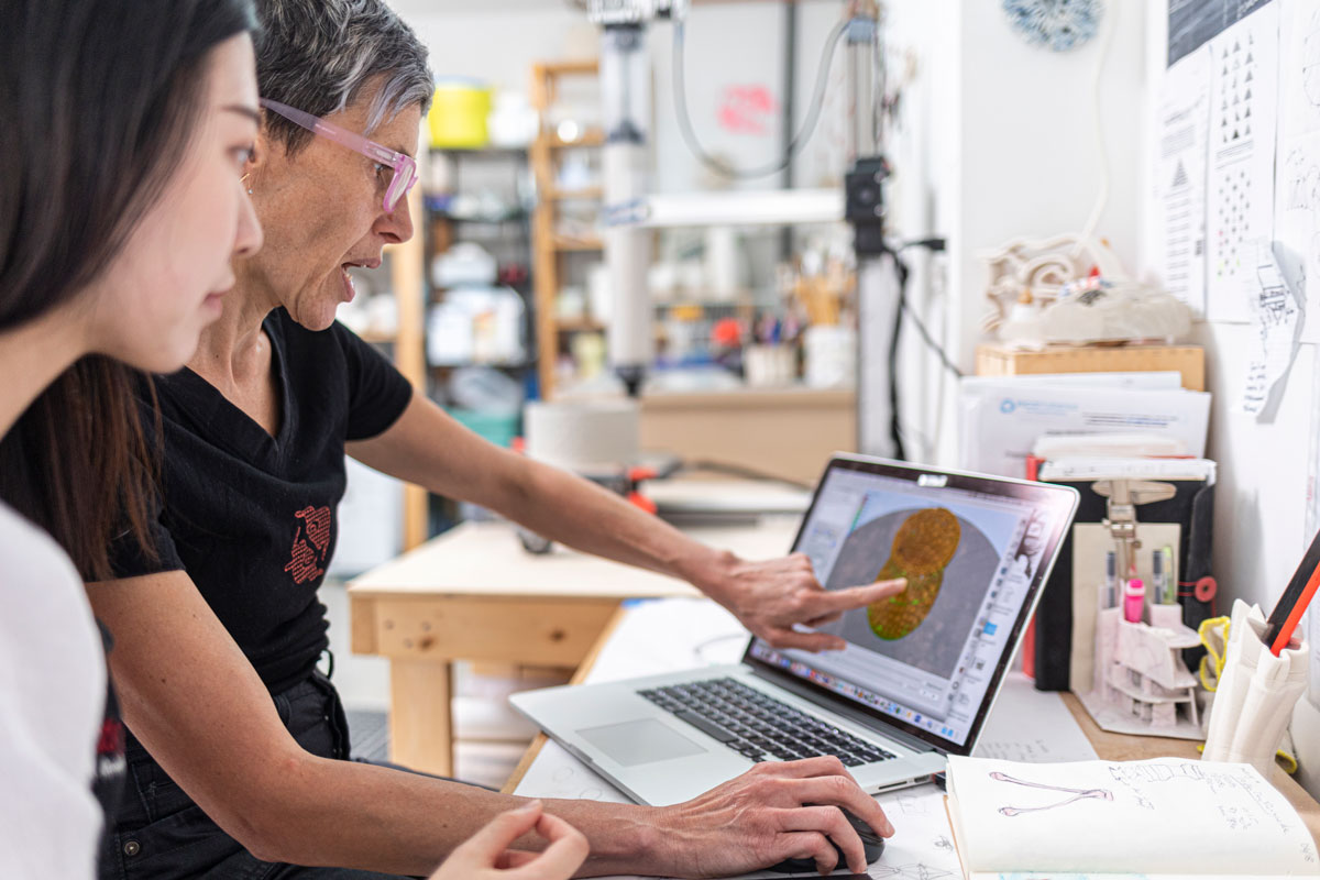Timea Tihanyi mentoring student intern Wanna Huang at Slip Rabbit Studio, Seattle, Washington, 2019. Photo by Mark Stone.