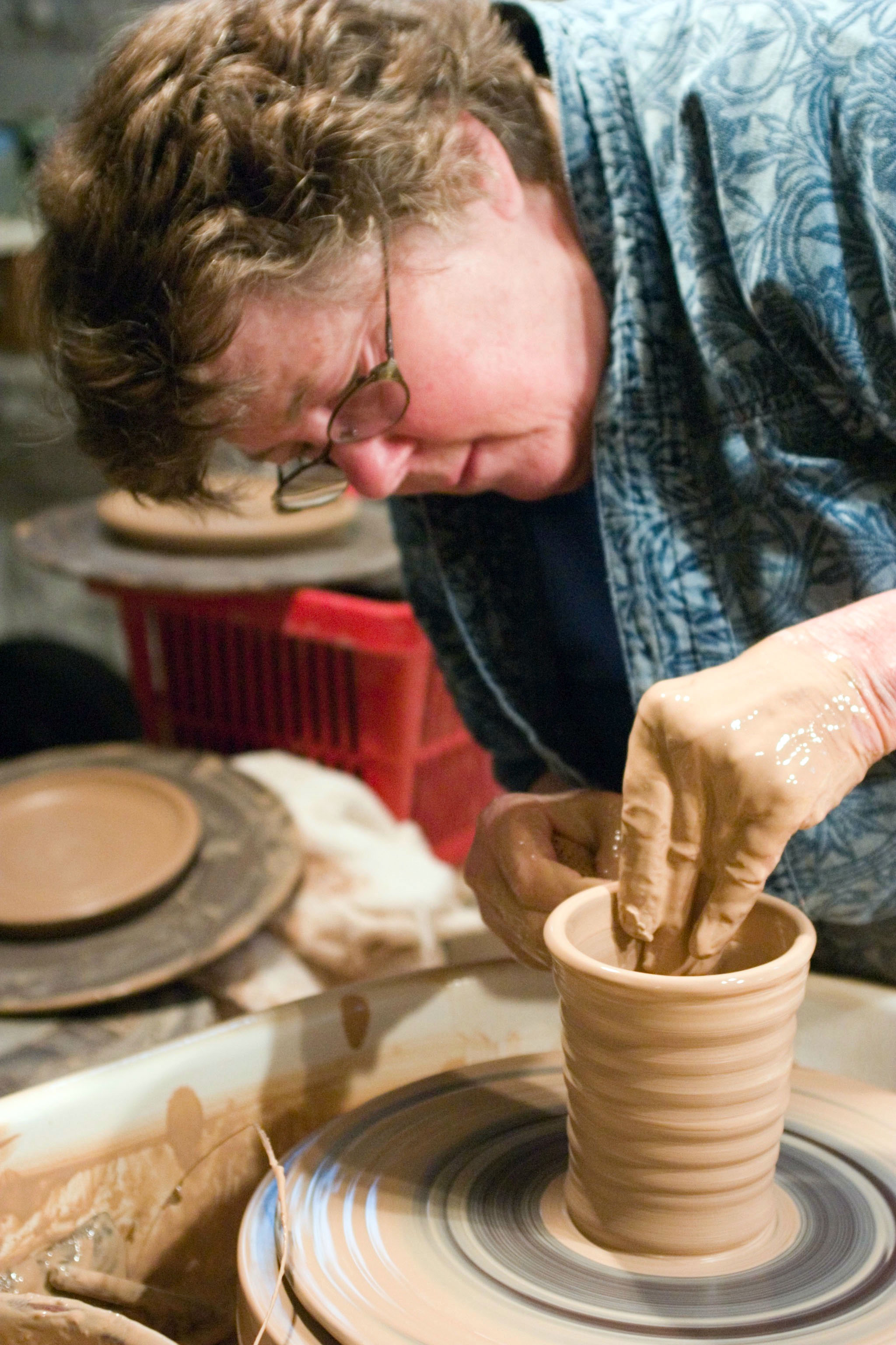 Kit at her wheel in her studio, 2005.