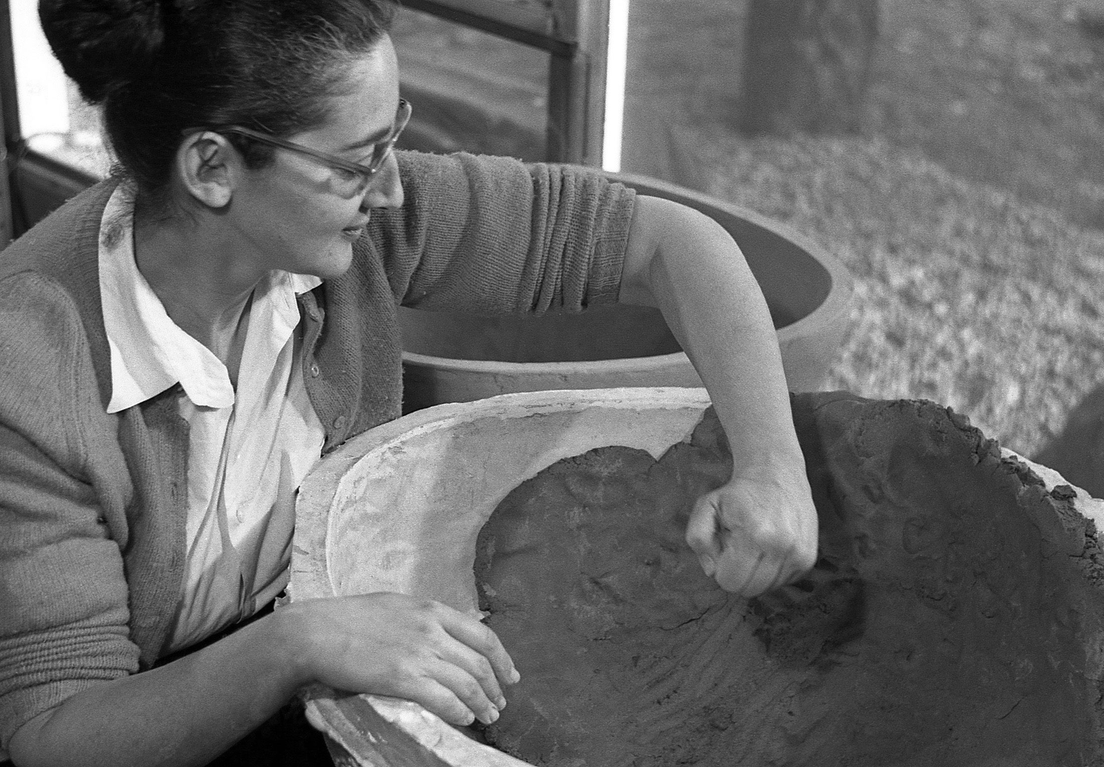 Karen Karnes working on a molded planter, 1957. Photo by Ross Lowell.