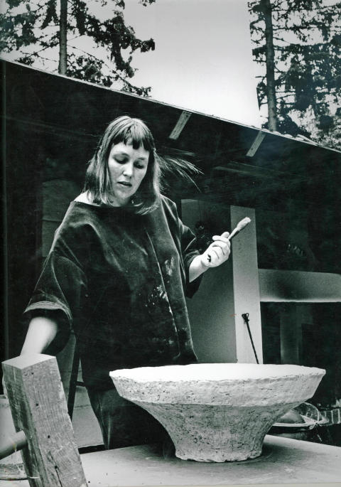 An early photo of the artist and sculptor Hertha Hillfon working in her studio at her home in Stockholm. Photo by Lars Lennart Forsberg.
