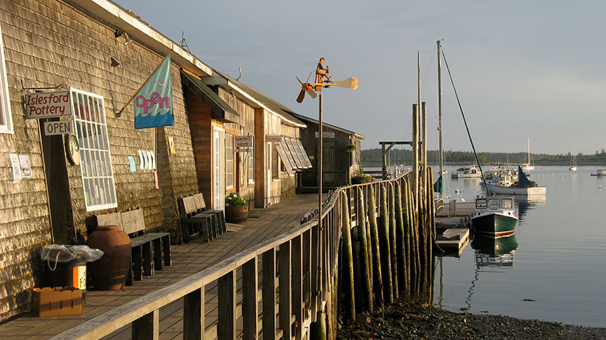 View of the front of Islesford Pottery and the pier.