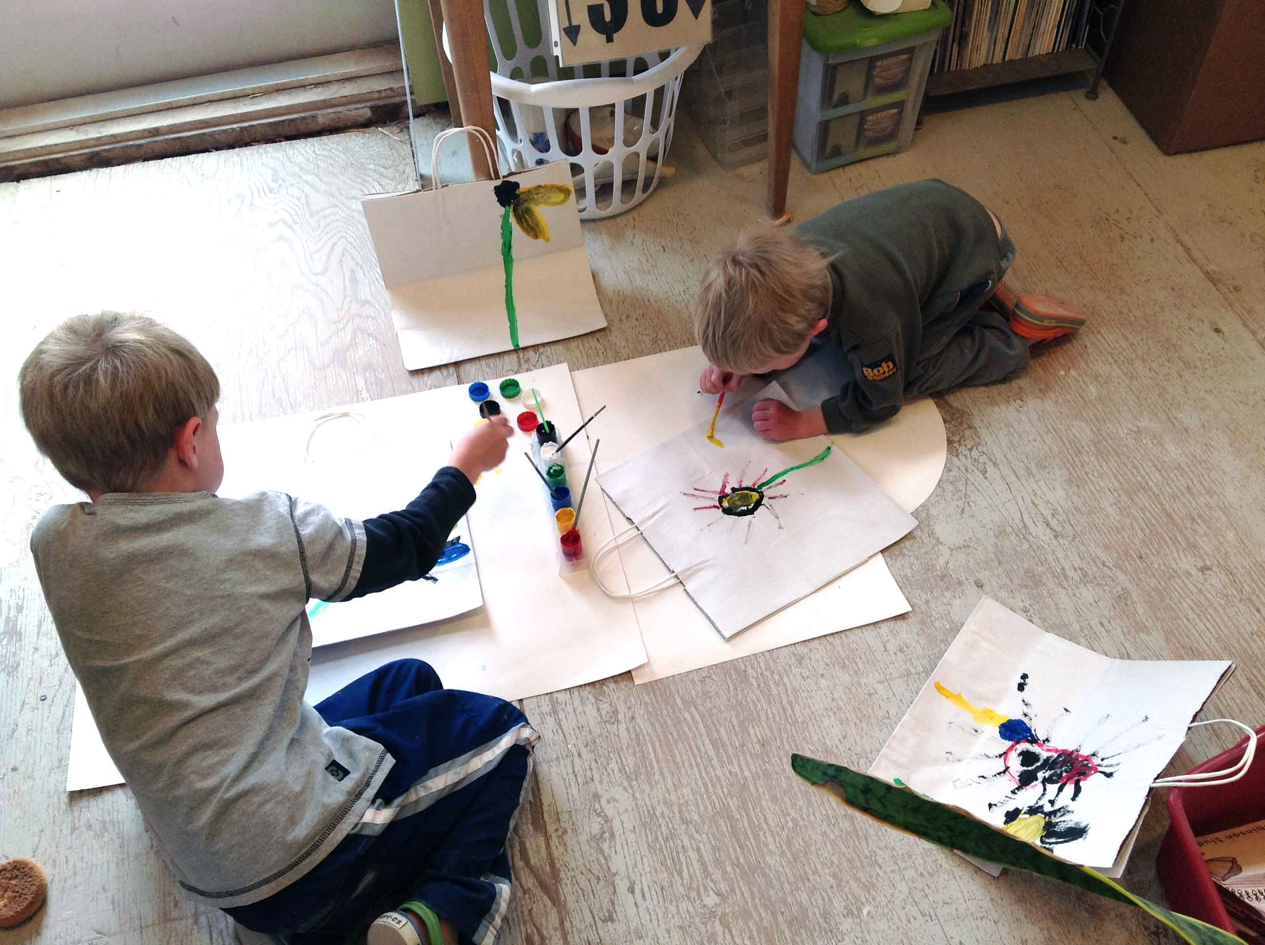 Robinson's kids decorating shopping bags with paints in her studio, 2016.