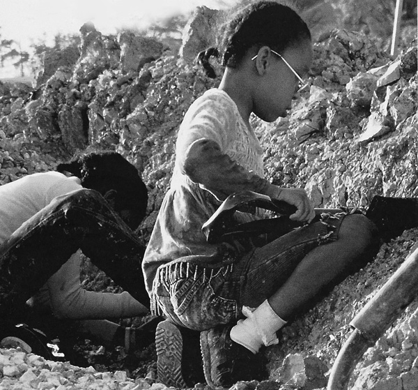 Local kids digging clay at the Stancills Mine, Maryland, 2005.