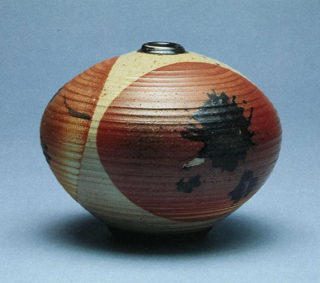 Woodfired Bottle. Porcelain, Double Dipped in Avery Clay With Black Slip Splash. 6 in. x 7 in. 1993.