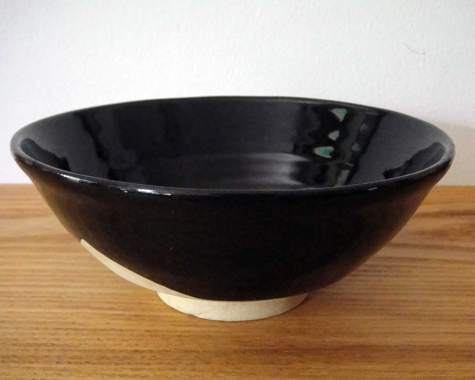 Black-glazed bowl, made in Tajimi, sold at Nagano station, 1967. Collection of Louise Cort.