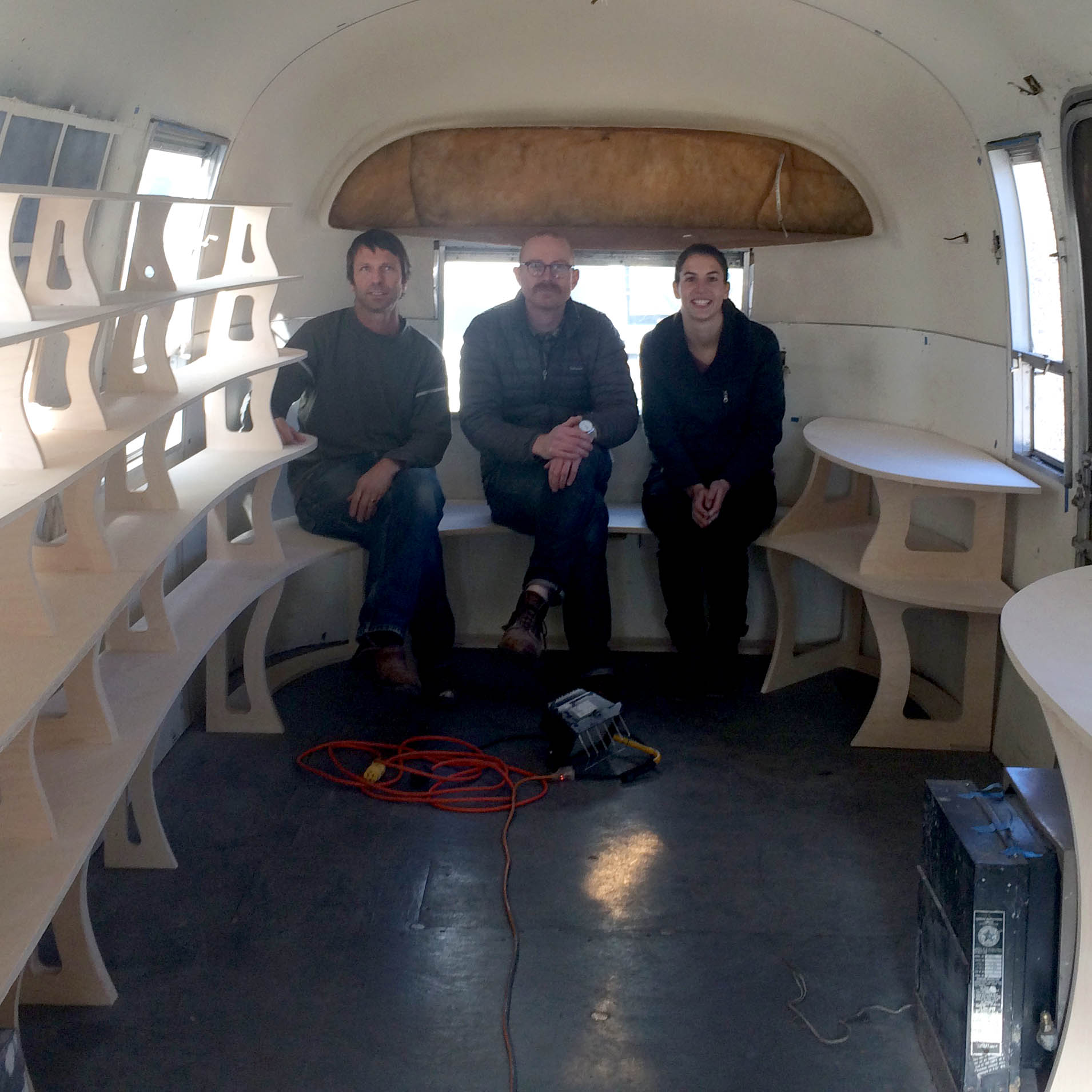 L to R: Alleghany Meadows, Del Harrow, and Camila Friedman-Gerlicz inside the Artstream 2.0 during construction.