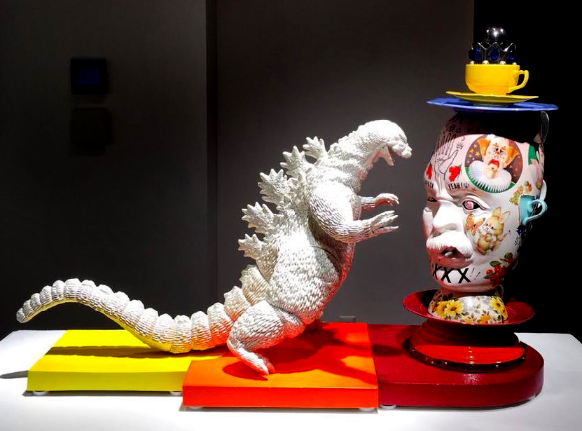 Mark Burns. Godzilla vs. King Kitsch, 2017. 28x40x14 in. Porcelain, glaze, plastic, metal, cement.