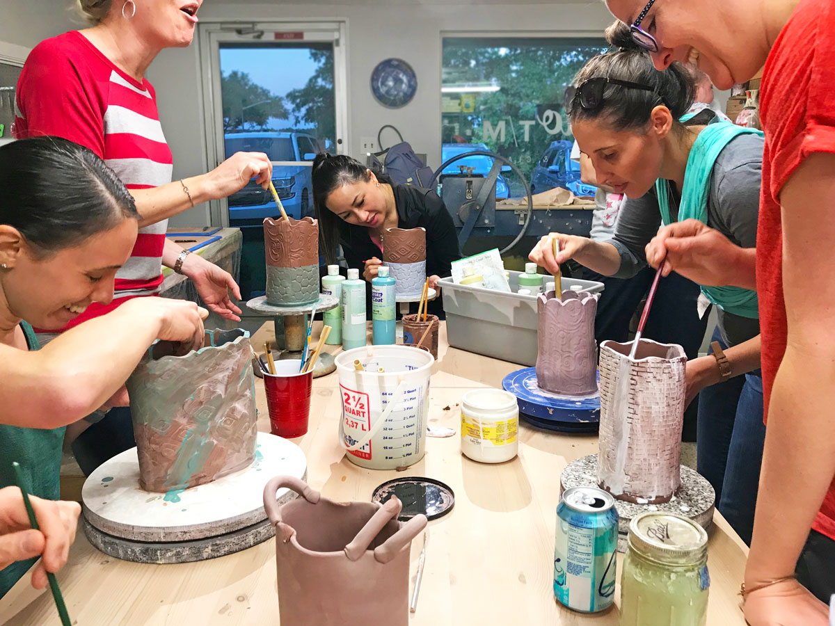 """Girls Night"" at Studio T/M Pottery, Gainesville, Florida. Participants build flower vases of their own designs. See Truman's article, ""Adventures in Rebuilding a High School Clay Program,"" page 18. Photograph by author."