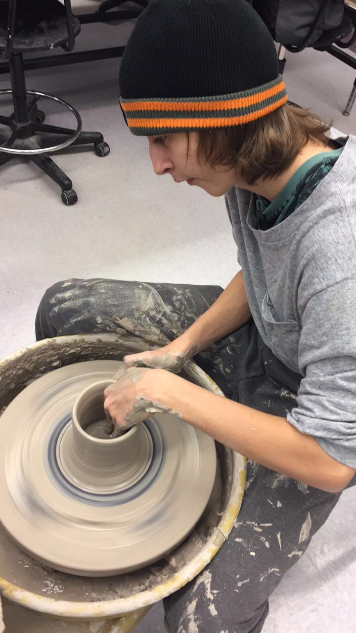 Preston Beckner throws on the wheel during the Advanced Ceramics class at Gainsville High School, 2017.