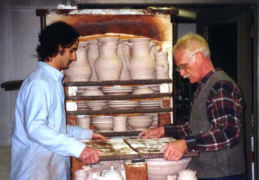 Mark Cole and John Glick load the gas reduction kiln at Plum Tree Pottery, 2001.
