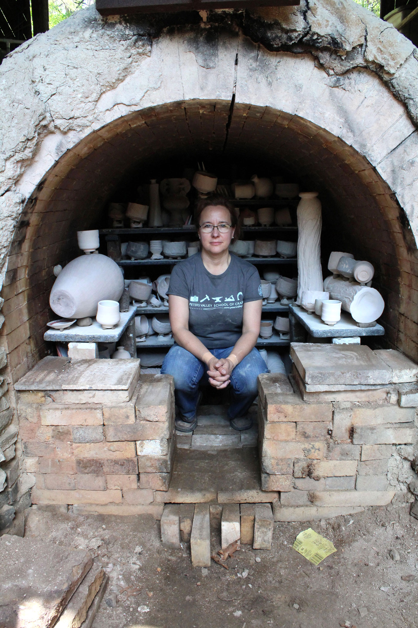 Kristin Muller in her anagama hybrid kiln built in 1995 by Okazaki Takao. Photo by Jacklyn Scott, 2016.