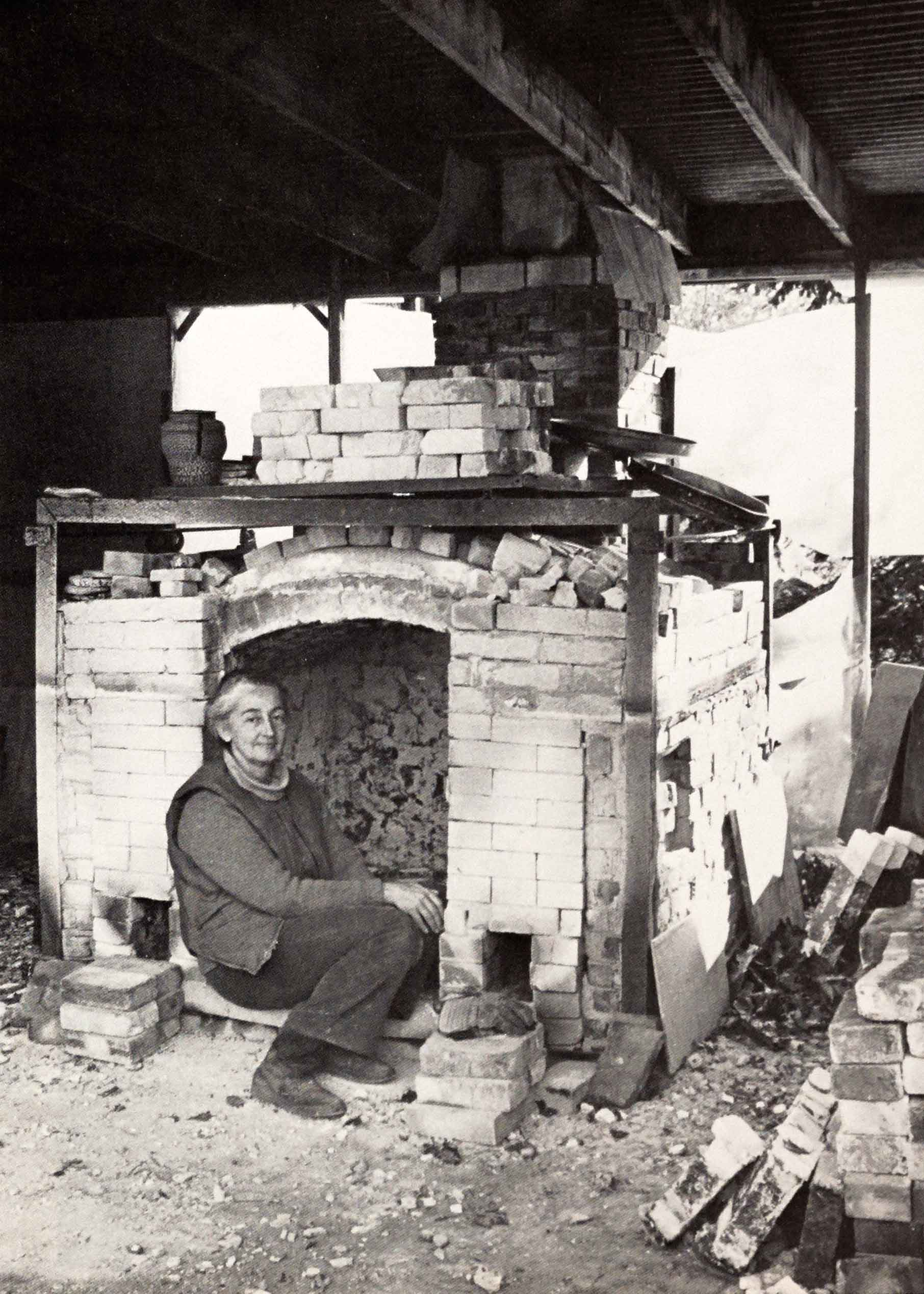 Karen Karnes in front of her salt kiln, 1976. From SP Vol. 5, No. 2.