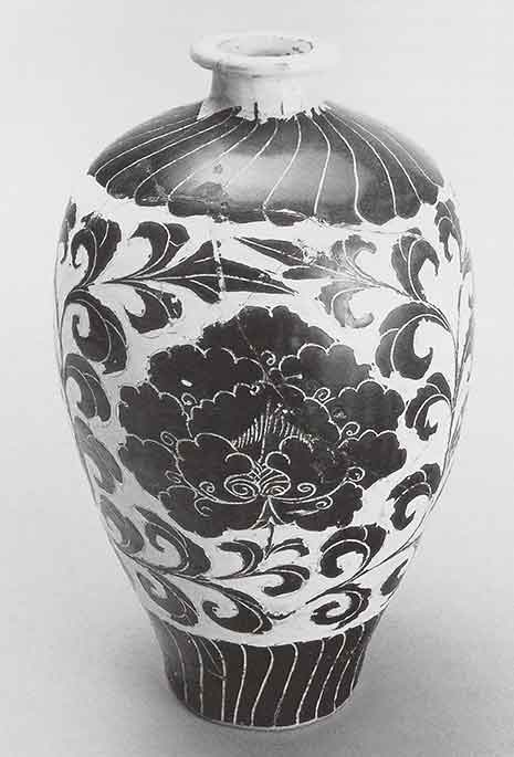 Bottle. Cizhou ware. China, Northern Song dynasty, late 11th-12th c. Stoneware with white slip and black slip under transparent glaze. 12.5 x 7.5 in.