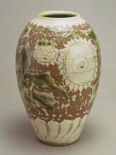 Jar with sgraffito design of sunflowers, 1947, Yagi Kazuo. Stoneware with white slip and clear and copper glazes. 12 x 8 in.