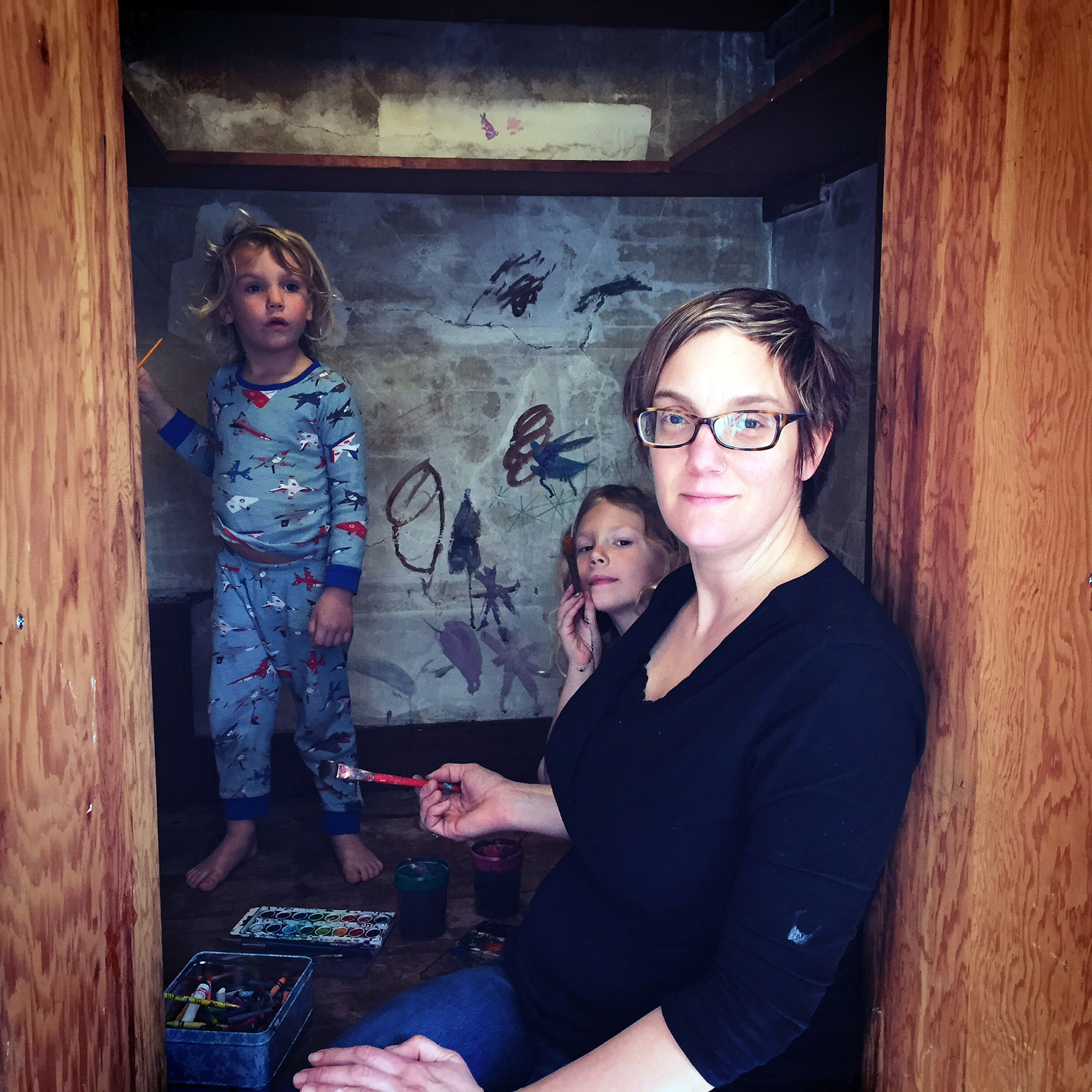 "In 2016, Ruby May, Heilo Blue and Kari decorating the ""magic room"" of their new home, originally built as cold/dry storage for food in the early 1900s. It's a kids-only club house where big play and imagination happens."