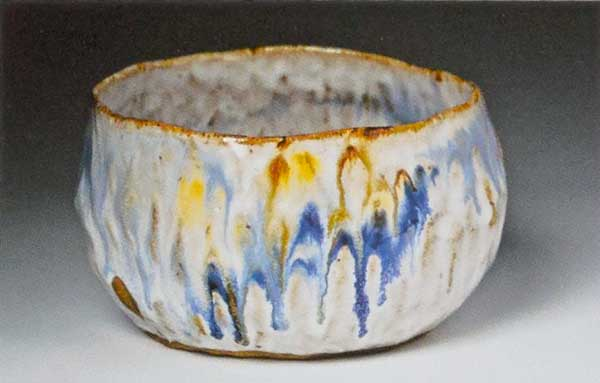 White clay, pinched. Milky glazed pot with splashes of blue and yellow and finger marks. 3 x 5.5 in. Photo by Joseph Szalay.