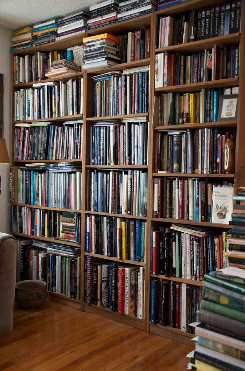 A few of the many, many shelve of pottery books in the author's home in Ashford, Connecticut. Photograph by Joseph Szalay, 2018.