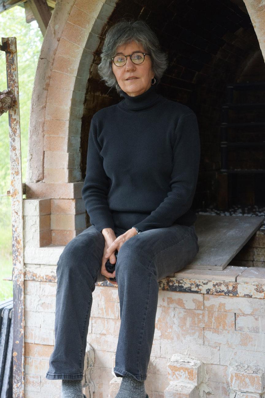 Gunda Stewart by her kiln, British Columbia, Canada.