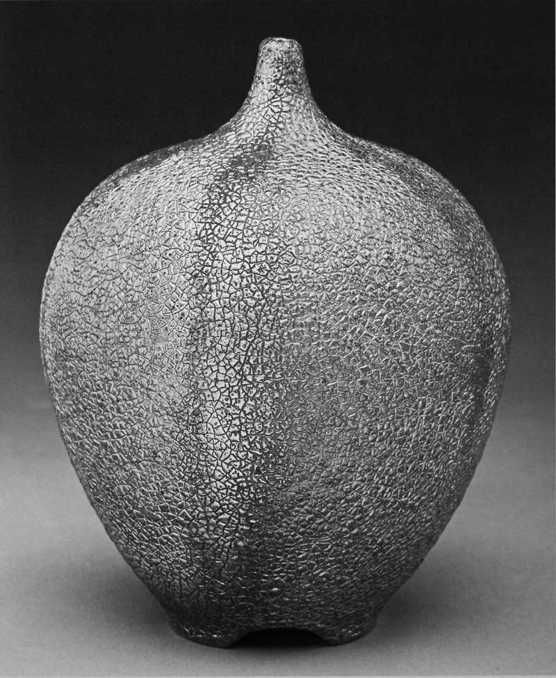 James C. Watkins. Bottle Form, 2013. Saggar-fired with Cone 04 glaze, fumed gold luster, 16 x 14 in. Photograph by Jon Thompson.