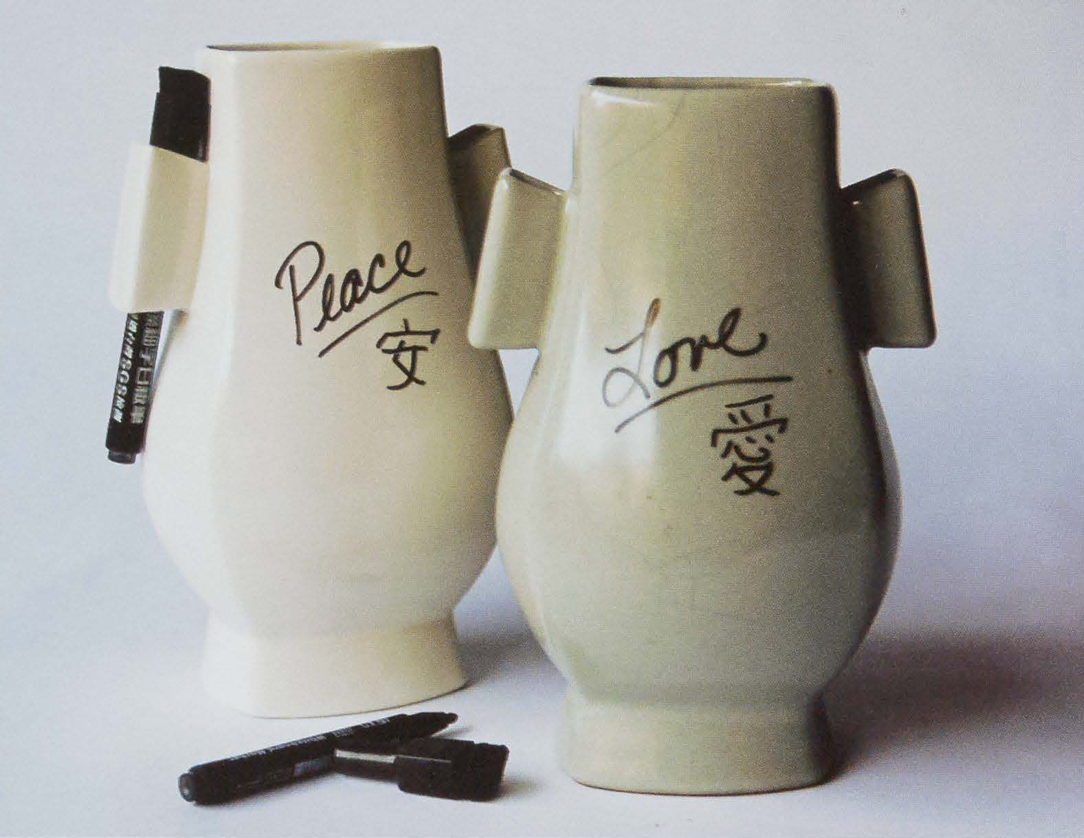 "Ears Vase, 2012. Stoneware, slip-cast 9.5 x 6 x 5 in. Based on an historic Guanware Chinese vase. Originally, the ""ears"" of the vase were meant for a carrying rope, but I replaced the rope with dry-erase markers introducing and interactive element to the"