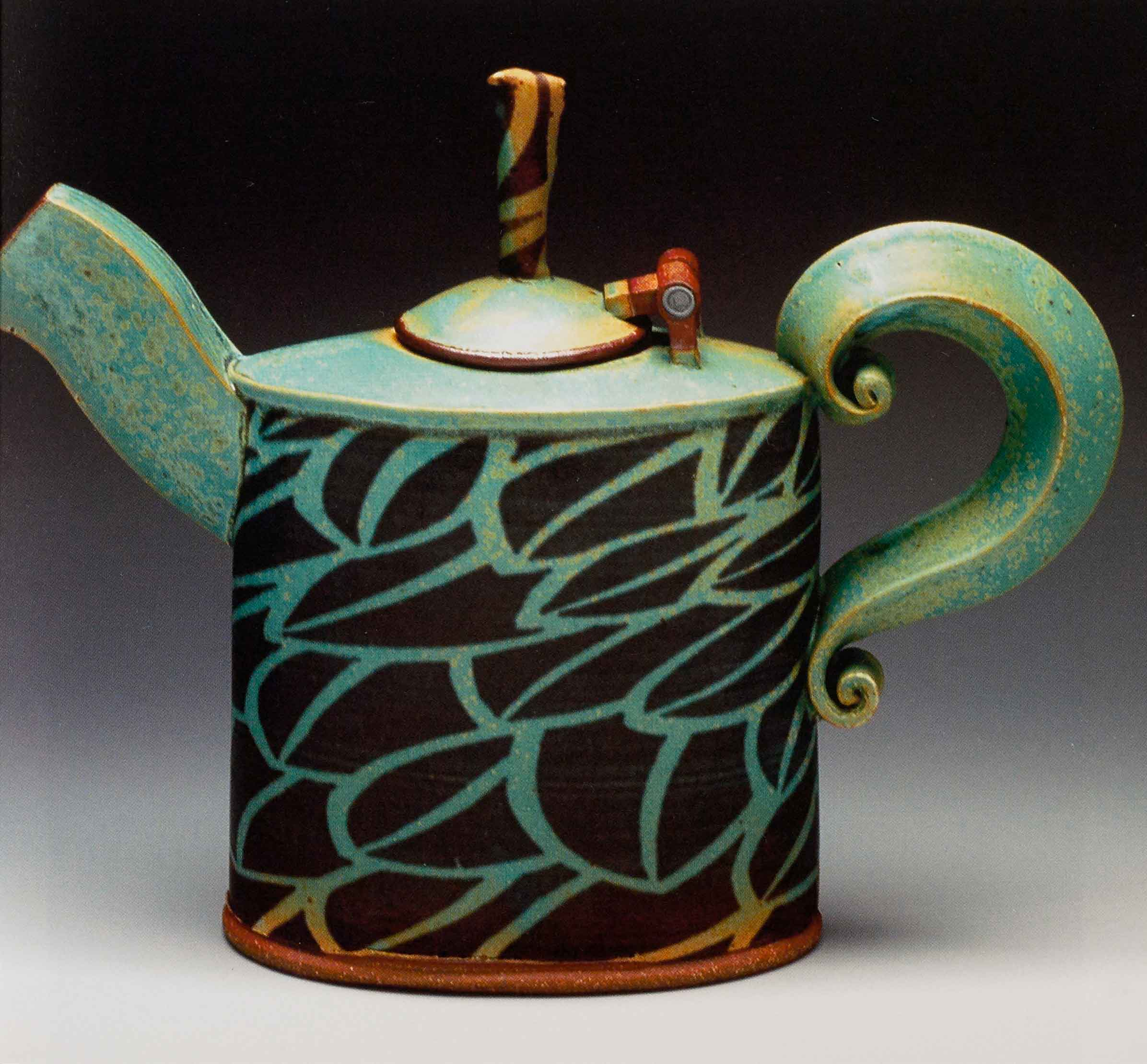 Teapot 10 inches tall. 2006. Stoneware, inlaid black slip, stretched slabs and extrusions, copper matt glaze, Cone 10 reduction.