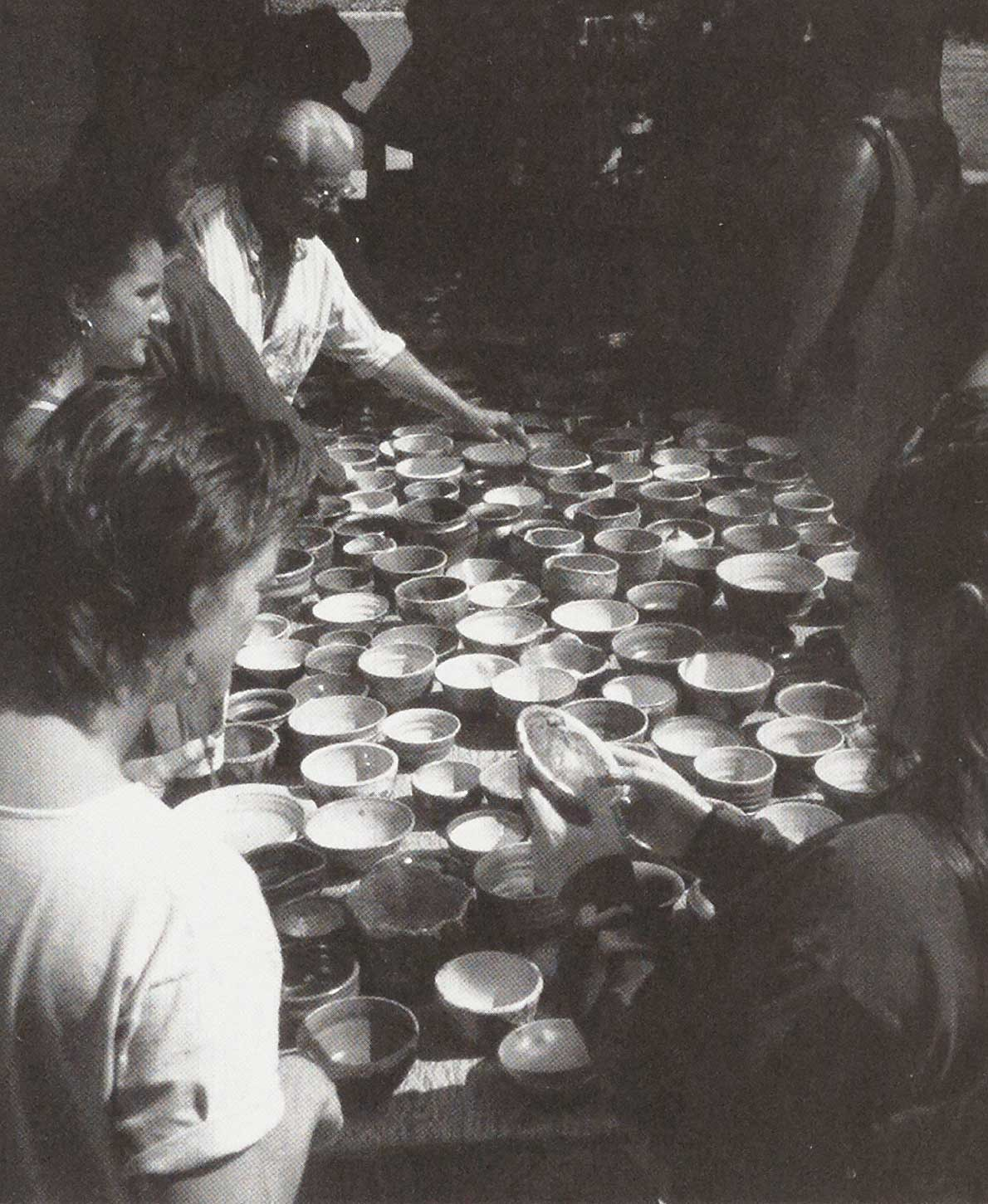Paulus Berensohn and students with Empty Bowl pots.
