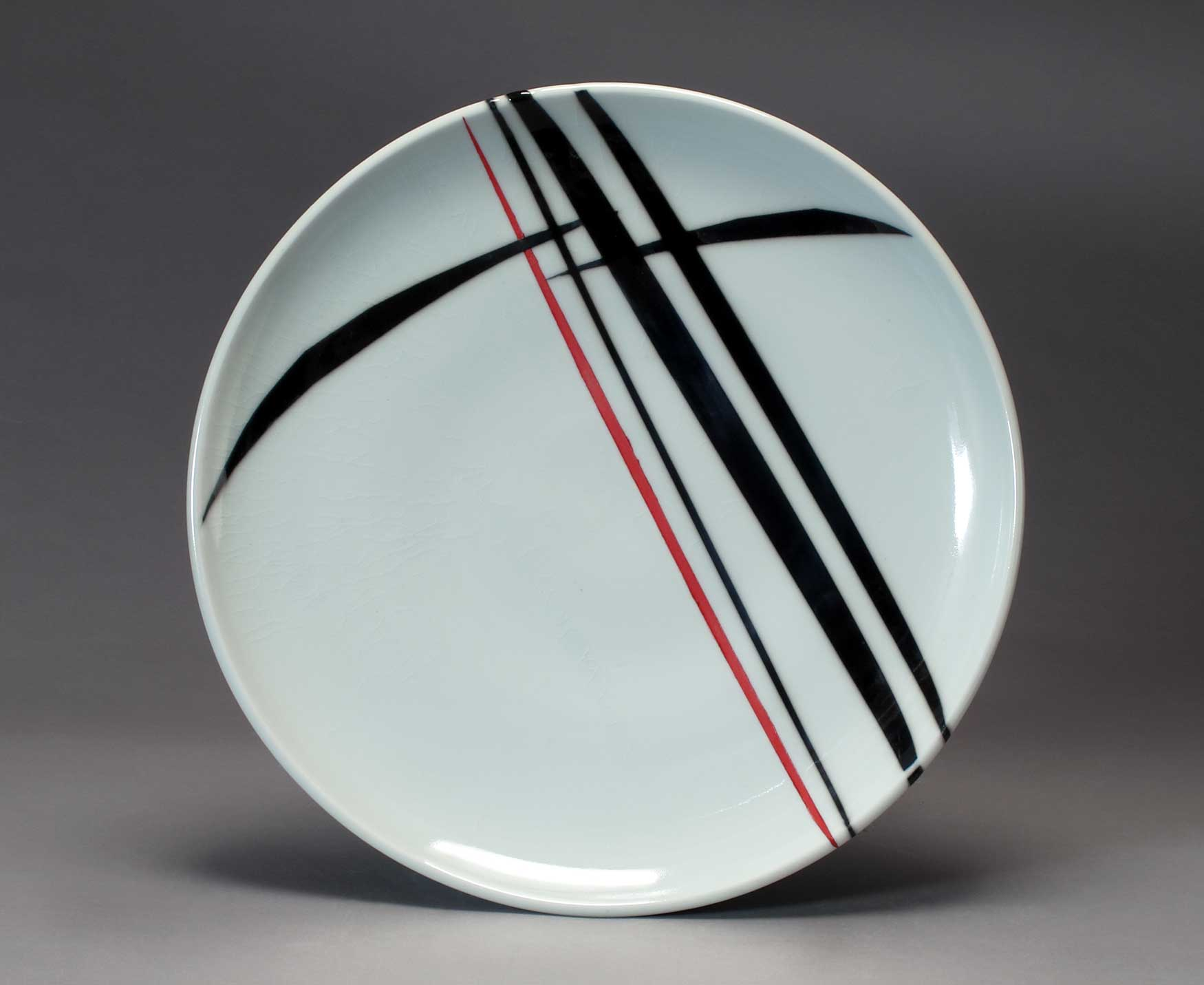 Shelley Schreiber. Platter, 2016. Wheel-thrown porcelain with colored slip, underglaze and  glaze, Cone 10 reduction, 1 x 12.5 in. Photo by artist.