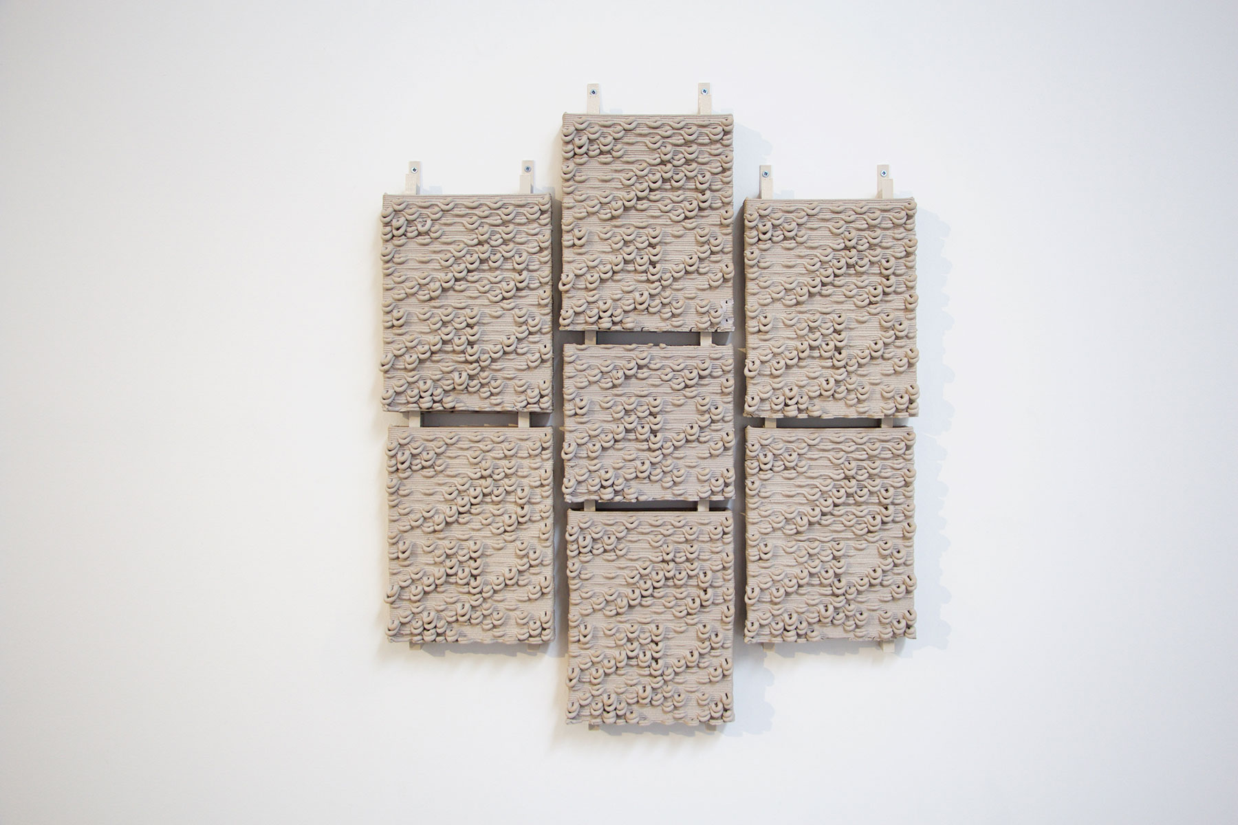 Ronald Rael, Virginia San Fratello, Kent Wilson, Alex Schofield. GCODE.Clay, 2016. Prototypes for ceramic cladding systems for building; each assembly is hung using custom, 3-D printed hardware.