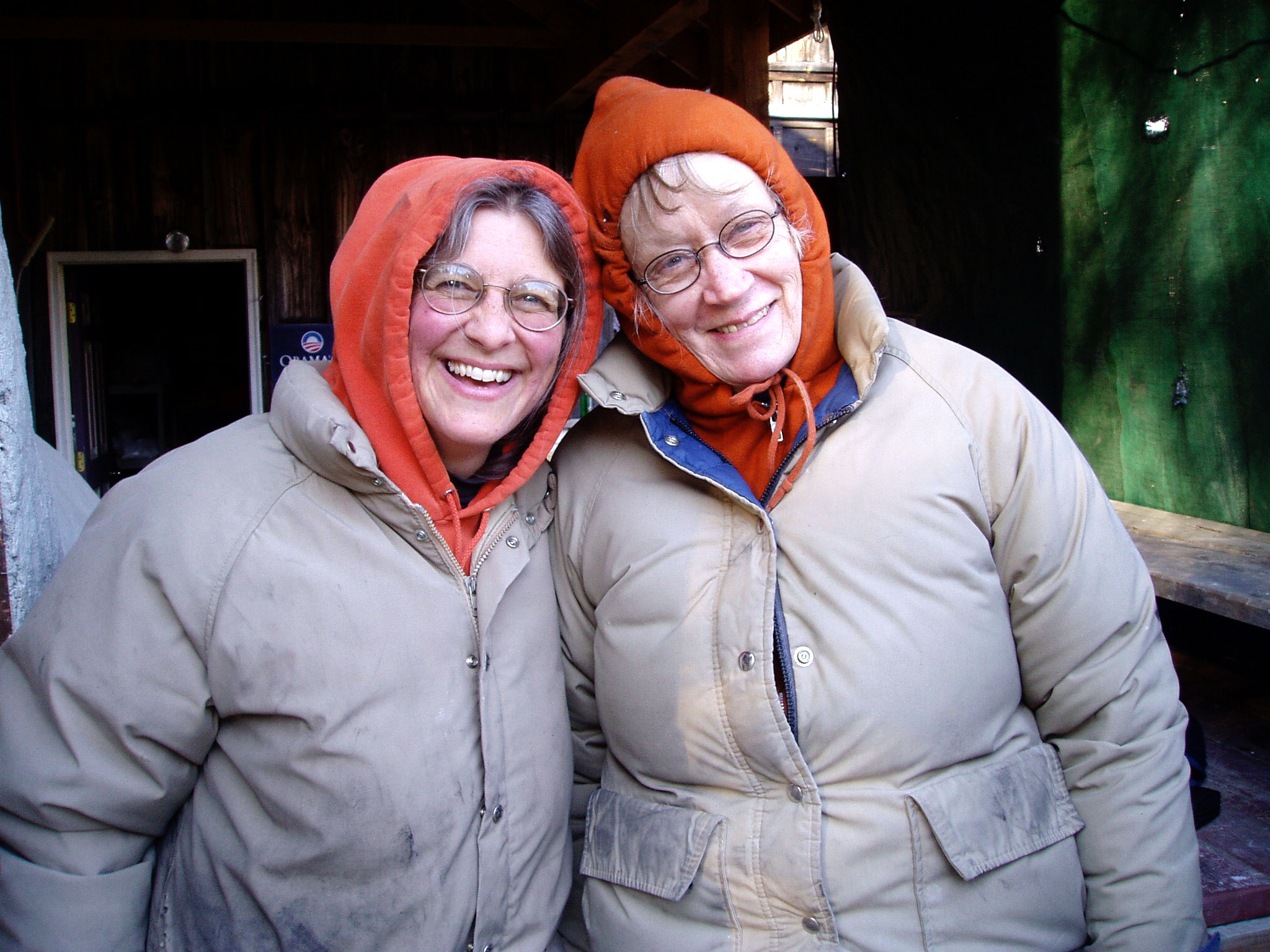 Paige Wilder, left, and the author, posing as twins at a firing in deep winter. Photo by Rolf Karlstrom, 2013.