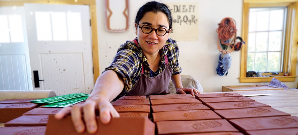"""Ayumi Horie works on """"Portland"""" bricks in her studio. Photograph by Janine Grant."""
