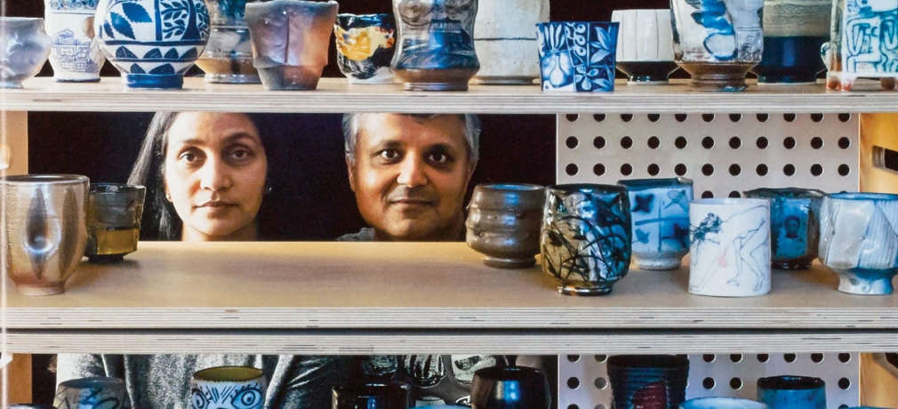 Jigna (left) and Sanjay (right) Jani behind various yunomi in their gallery, Iowa City, Iowa, USA, 2014.