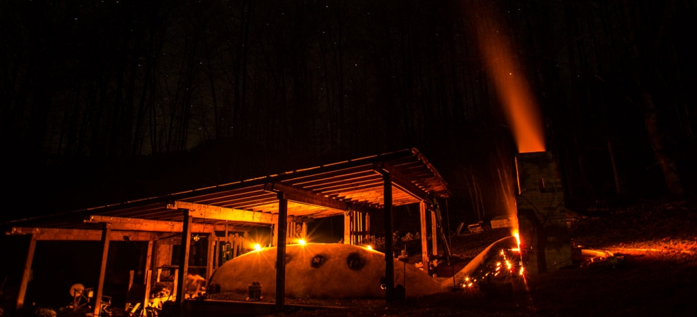 Noah Hughey-Commers's anagama firing at night, Muddy Creek Pottery, Lovingston, Virginia. Photograph by Peter Rausse, 2015.