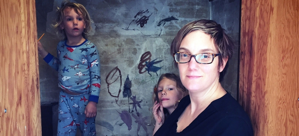 """In 2016, Ruby May, Heilo Blue and Kari decorating the """"magic room"""" of their new home, originally built as cold/dry storage for food in the early 1900s. It's a kids-only club house where big play and imagination happens."""