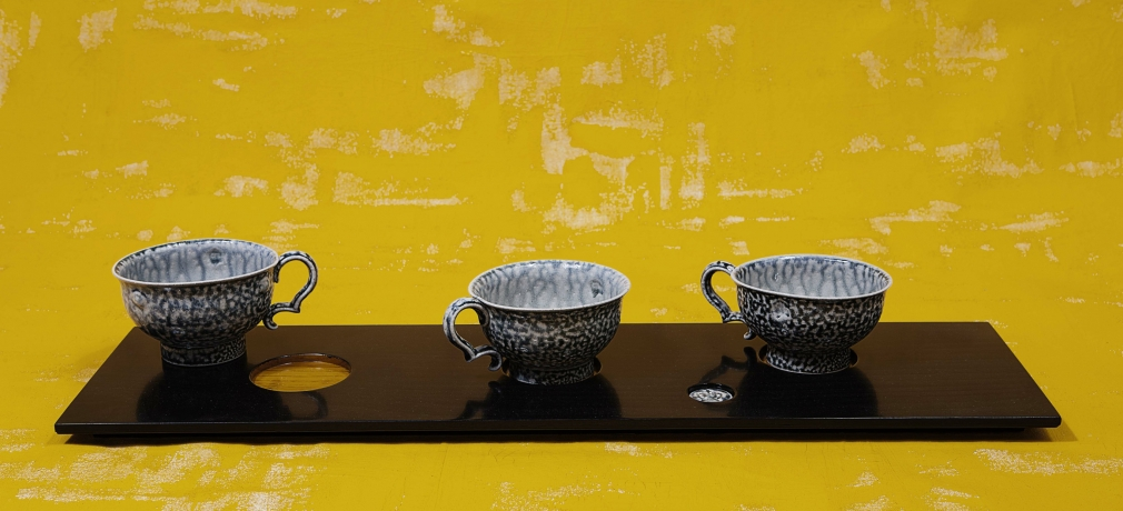 """Work from """"Cup Board"""" by Steve Harrison, photograph by Richard Cannon"""