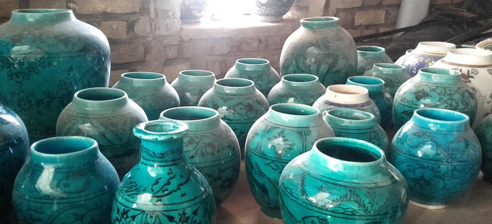 These turquoise pots represent a changing pottery tradition. The fish motif  is traditional to the area around the village of Shah Reza, but the forms  and color cater to current fashions.