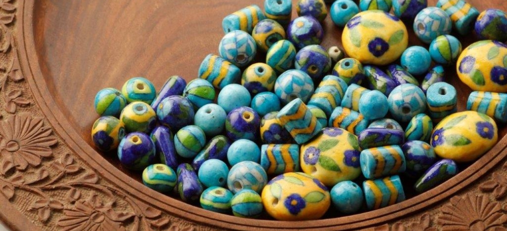 Neerja International. Jaipur blue pottery beads for making accessories.