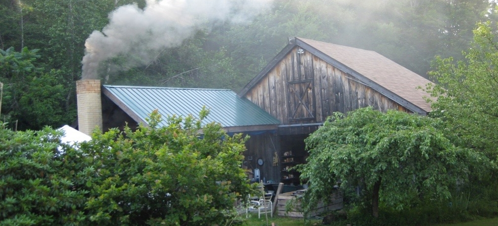 Entrance to Magnusson's studio barn and kiln shed, with a firing underway. Photo by the author, 2010.