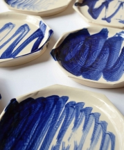 Digital Calligraphy, 2015. CNC painted plates with handmade brush. Porcelain, cobalt, glaze, 8x8x1 in. Photo by artist.