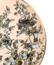 Yu Jiaqi, Through the Looking Glass; serving platter detail, 2017. Bone china, slipcast, overglaze decals, gold luster decals, hand painted overglaze and gold luster, 1 x 12.5 x 12.5 in. Photograph by Nick Geankoplis.