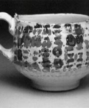 Cup, 2010. Earthenware, slip, toner resist transfer, glaze. 4 x 4 x 4 in.