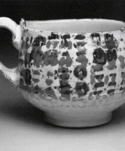 Cup, 2010. Earthenware, slip, toner resist transfer, glaze. 4 x 4 x 4 in.