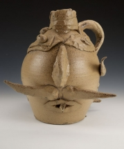 A collaborative piece by McCarthy and a student, Ben Z., made as a modern reinterpretation of face jugs. Wheel-thrown stoneware, altered, wood-fired to Cone 10, salt-glazed, 13.5 x 10 x 9 in.