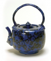 Norm Schulman. Blue Teapot, 1989. Salt-glazed porcelain. 8.5 x 7 x 5.75 in. Collection of Collection of Dorothy and Clyde Collins.