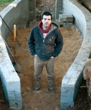 Noah Hughey-Commers starting work on the foundation of his kiln, February 2013. Photo by Stephanie Gross.