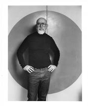 John Stephenson in front of his studio kiln room door, 1988. Photograph by Dirk Bakker.
