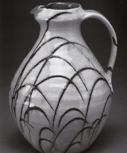 Pitcher. White slip with creek slip trailed over ash/feldspar glaze. 10.5in.