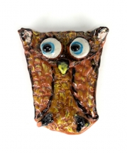 A teaching artist's sample of the folded-owl project, in which participants can build texture with limited manual dexterity.