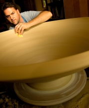 Ben making a large bowl for an installation, 2008. 16x48x48 in. Photograph by Jerry Wolford