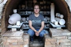 Kristin Muller in her anagama hybrid kiln built in 1995 by Okazaki Takao. Photo by Jacklyn Scott, 2016.